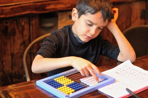 Abacus and worksheet boy
